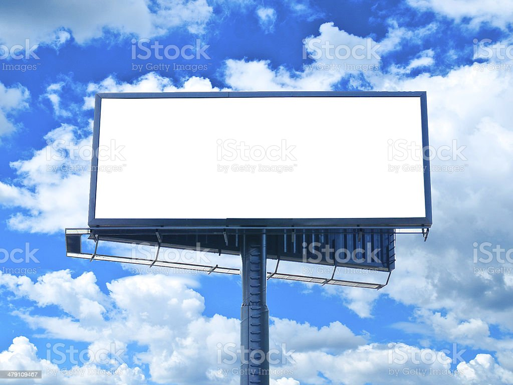 Huge empty billboard against blue sky stock photo