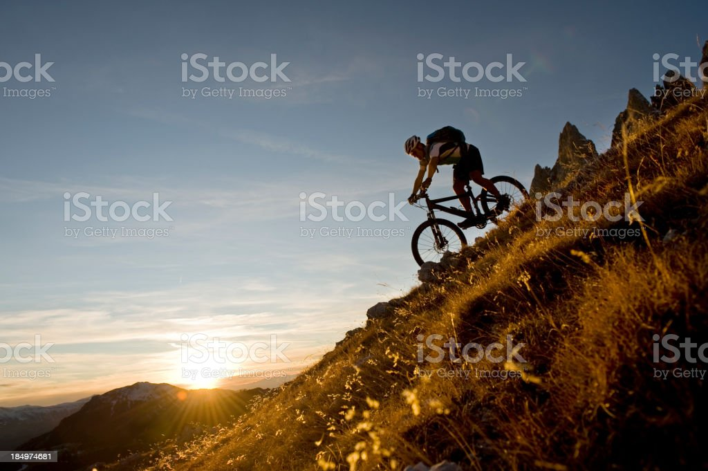 Huge Evening on a mountain bike ride into the valley stock photo