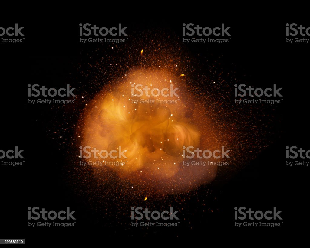 Huge, extremely hot explosion with sparks and hot smoke, against black background stock photo