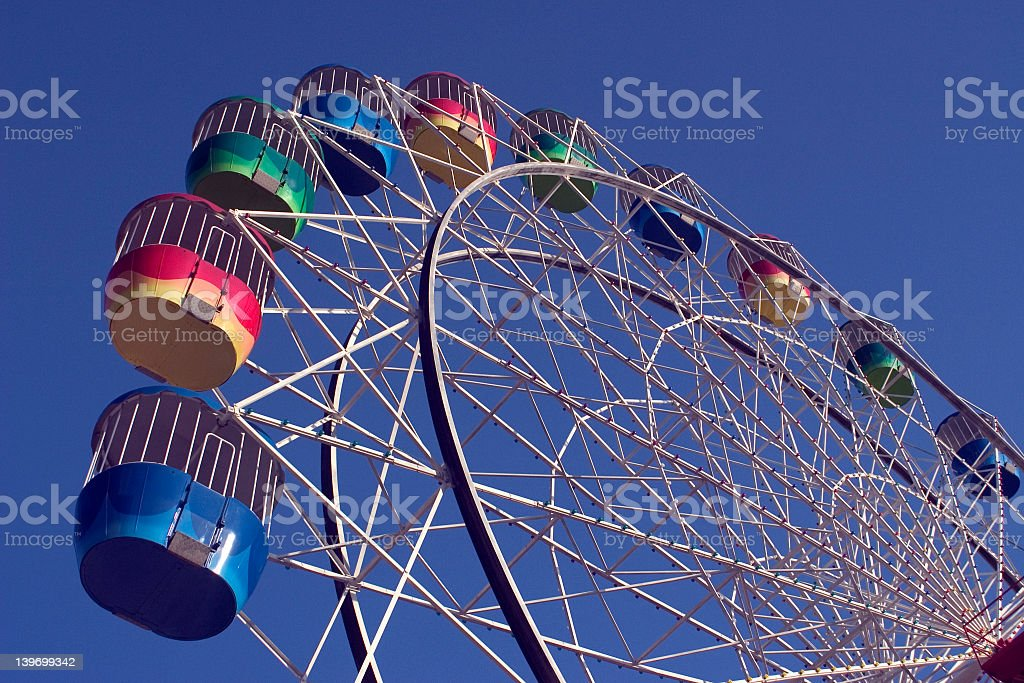 A huge ferris wheel on a sunny day stock photo