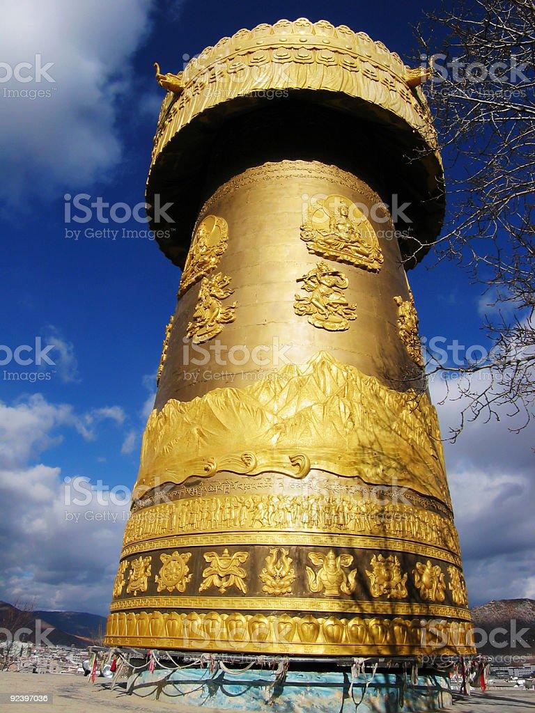 huge golden tibetian prayer wheel stock photo