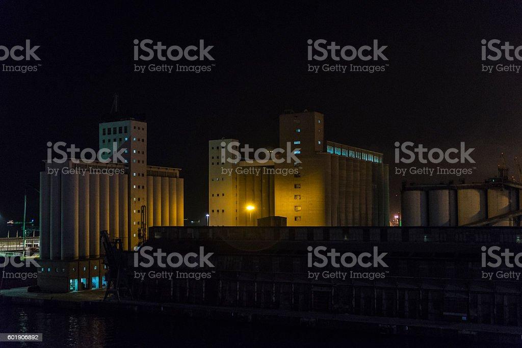 Huge grain silos at night stock photo