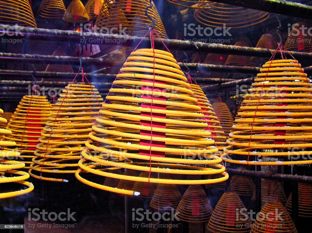 Huge incense sticks in a Buddhist temple stock photo