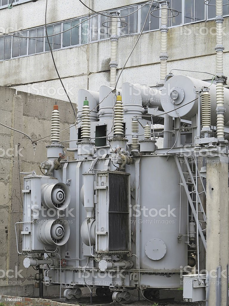 Huge industrial high-voltage substation power transformer on rai royalty-free stock photo