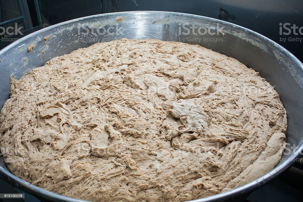 Huge mechanism for dough mixing at bakery royalty-free stock photo