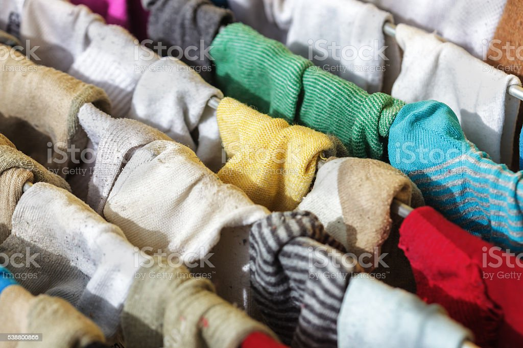 huge number of socks in the dryer after washing. stock photo