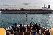 huge oil tanker ahead of passenger ferry - bosphorus Istanbul
