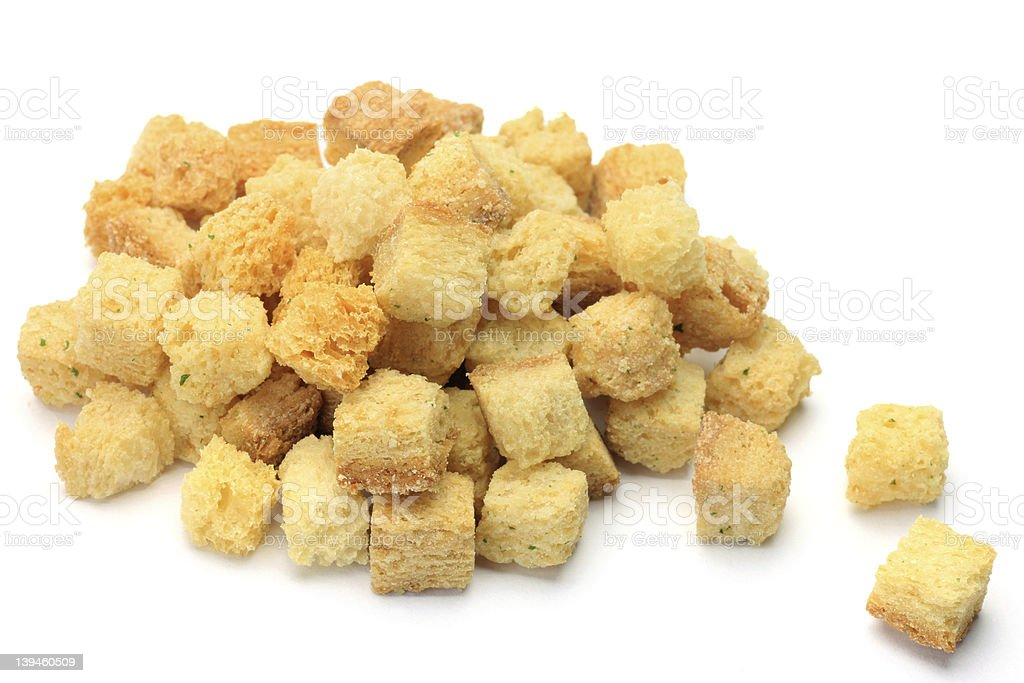 Huge pile of bread croutons in a white background stock photo