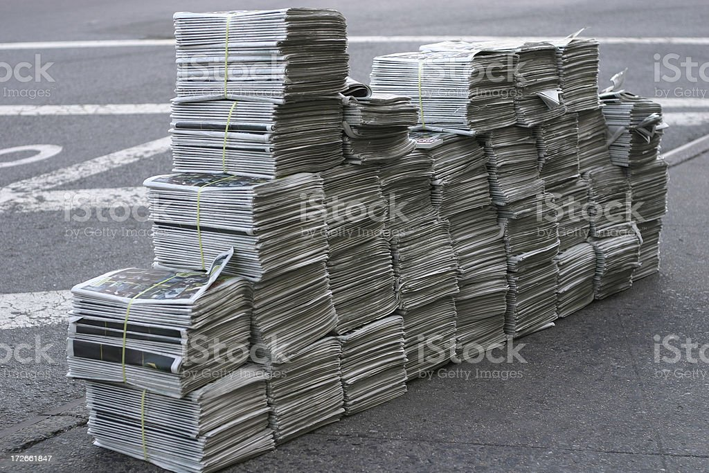 Huge pile of free newspapers stock photo