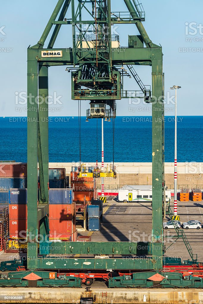 Huge port crane surrounded by containers stock photo