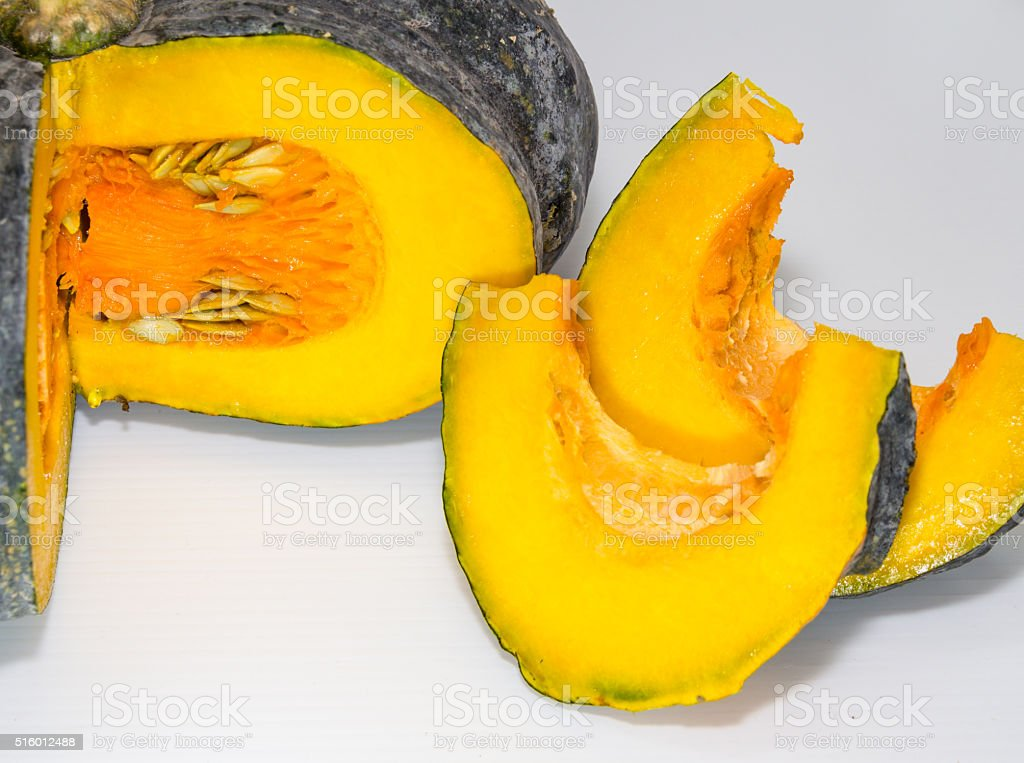 Huge pumpkin indented and two pieces of its. stock photo