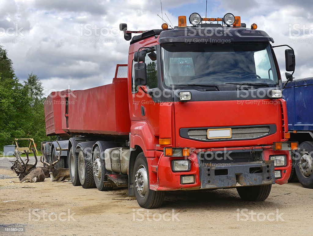Huge red truck and reindeer royalty-free stock photo