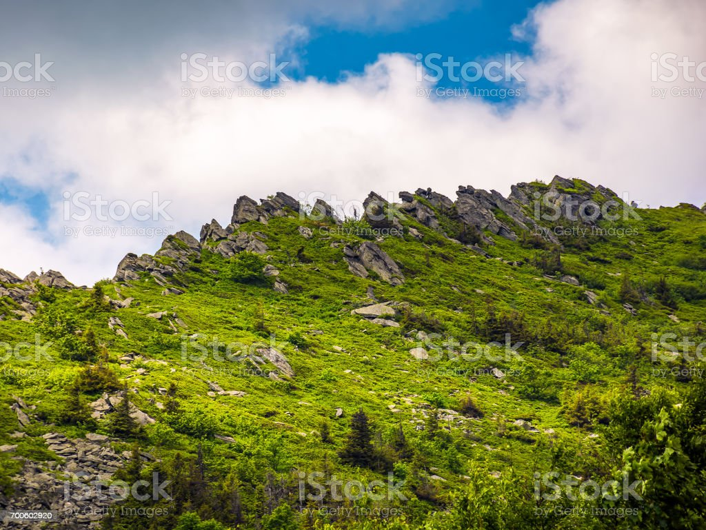huge rocks on the edge of a mountain ridge stock photo