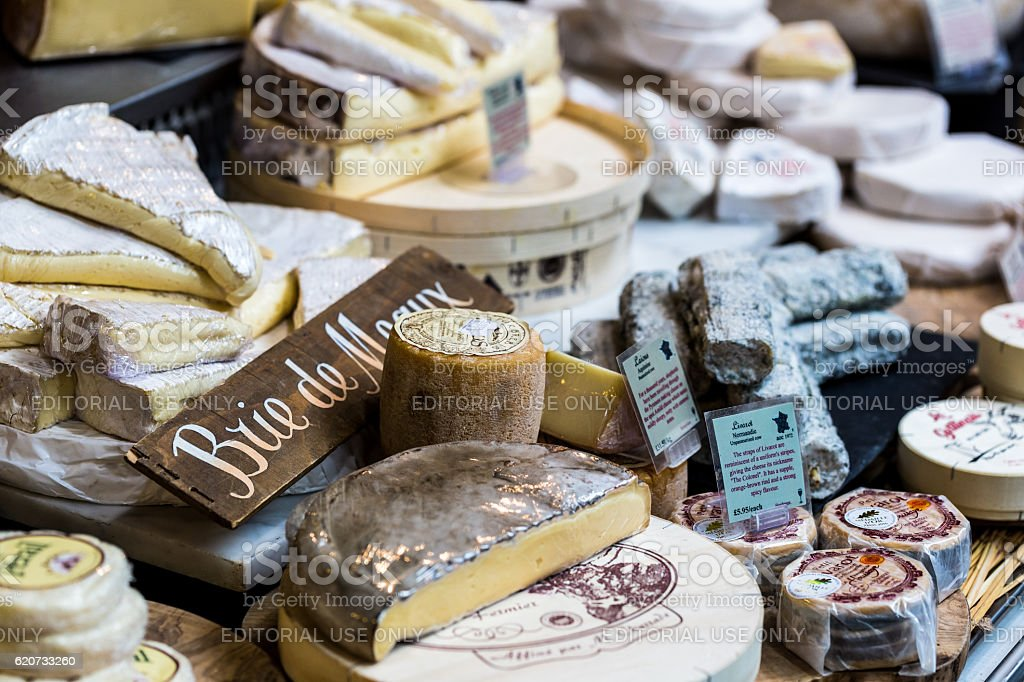 Huge selection of cheeses on stall, Borough Market, London, UK stock photo