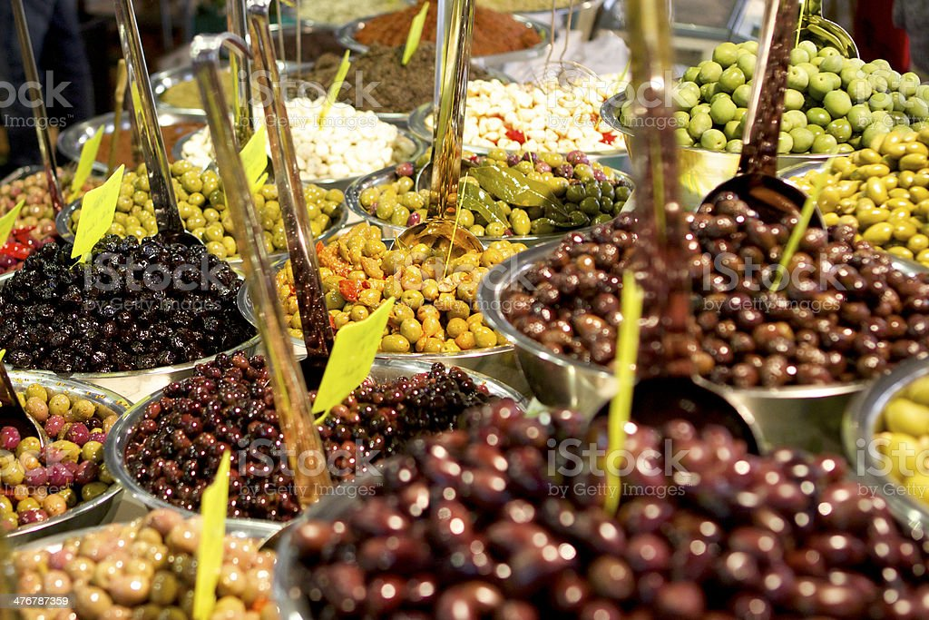 Huge selection of olives at French Market stock photo
