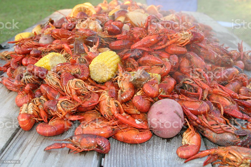 Huge serving of crawfish boil with vegetables stock photo