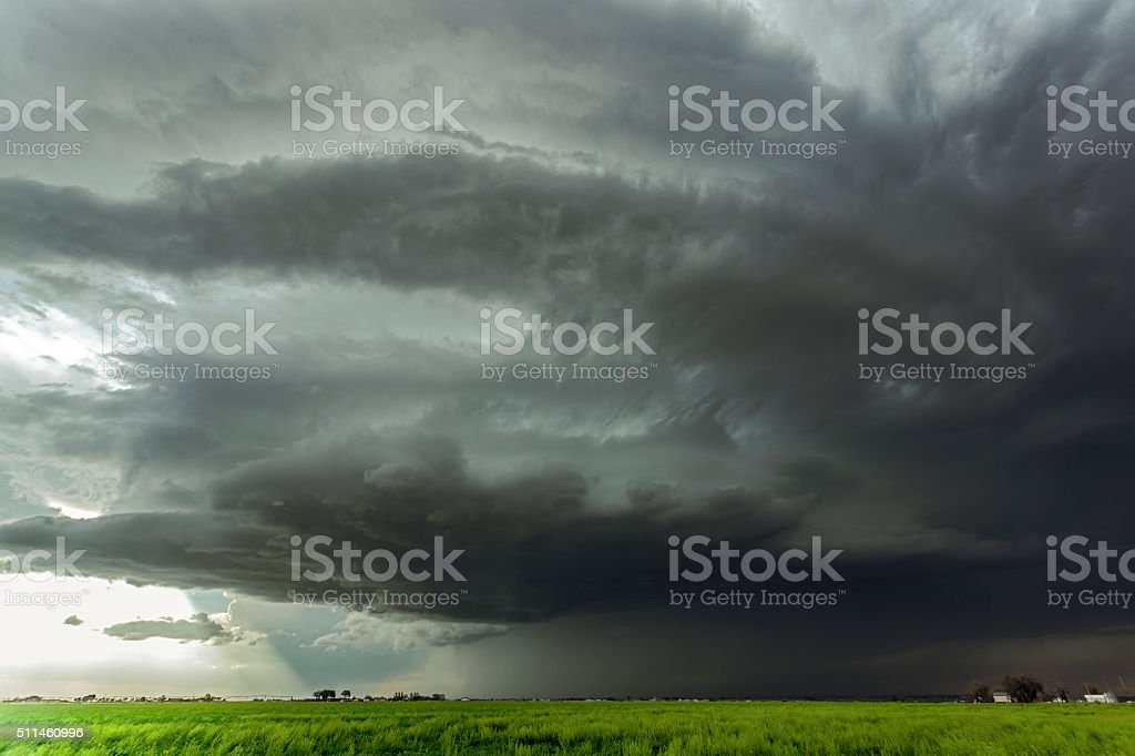 Huge, severe thunderstorm threatens small farming community stock photo