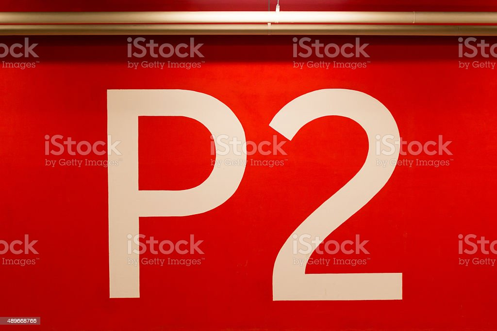 P2 huge sign painted on the red wall stock photo