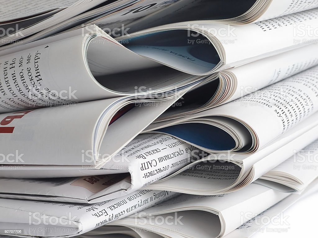 A huge stack of folded newspapers stock photo