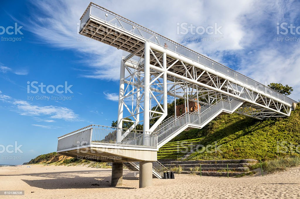 Huge steel stairway from a high cliff to the beach stock photo