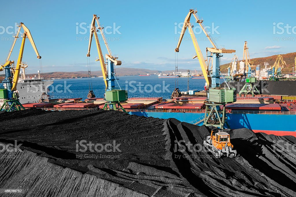 Huge stock of coal in the seaport. stock photo