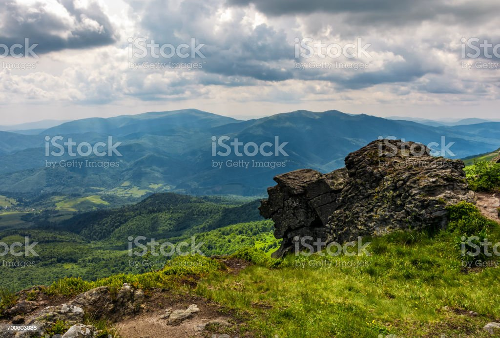 huge stone on the edge of a hill stock photo