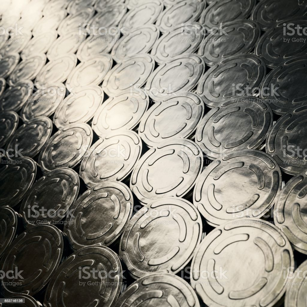 Huge Surface of Layered Lines of SHiny Metal Retro Film Reel Cans stock photo