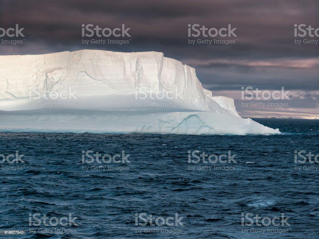 Huge Tabular Iceberg floating in Bransfield Strait at susnet,  Antarctica stock photo