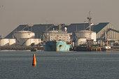 Huge tanker ship moored to a wharf