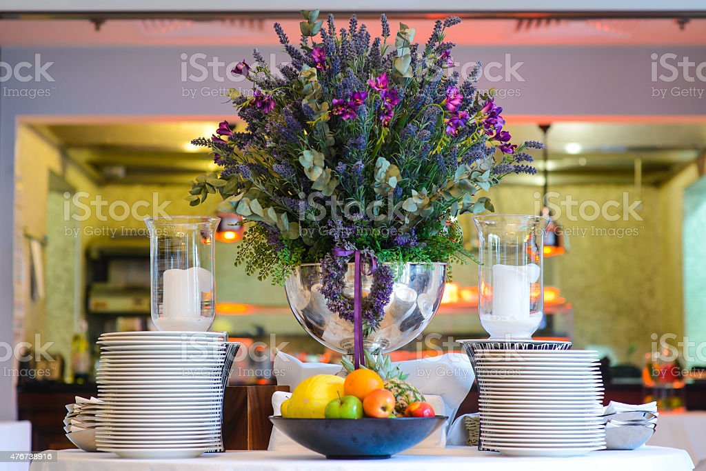 Huge vase of flowers on decorated table in the restaurant. stock photo