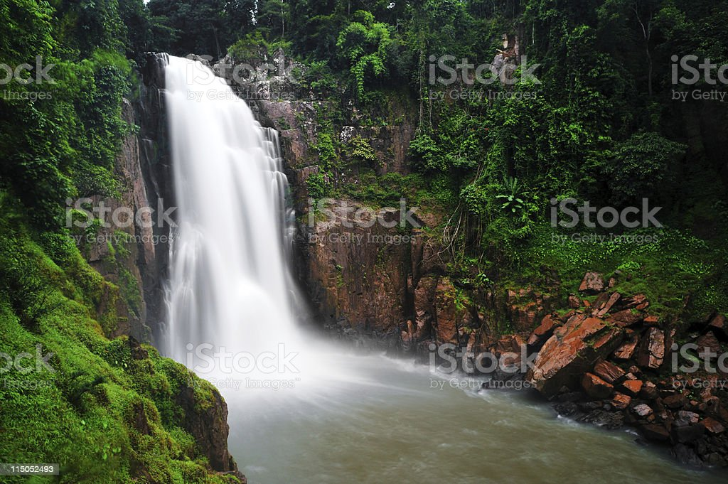 huge waterfall in the middle of jungle royalty-free stock photo