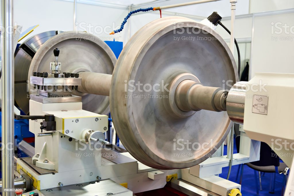 Huge wheels of train in lathe stock photo