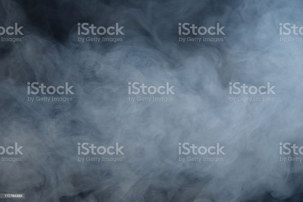 Huge white cloud of smoke in a dark room stock photo