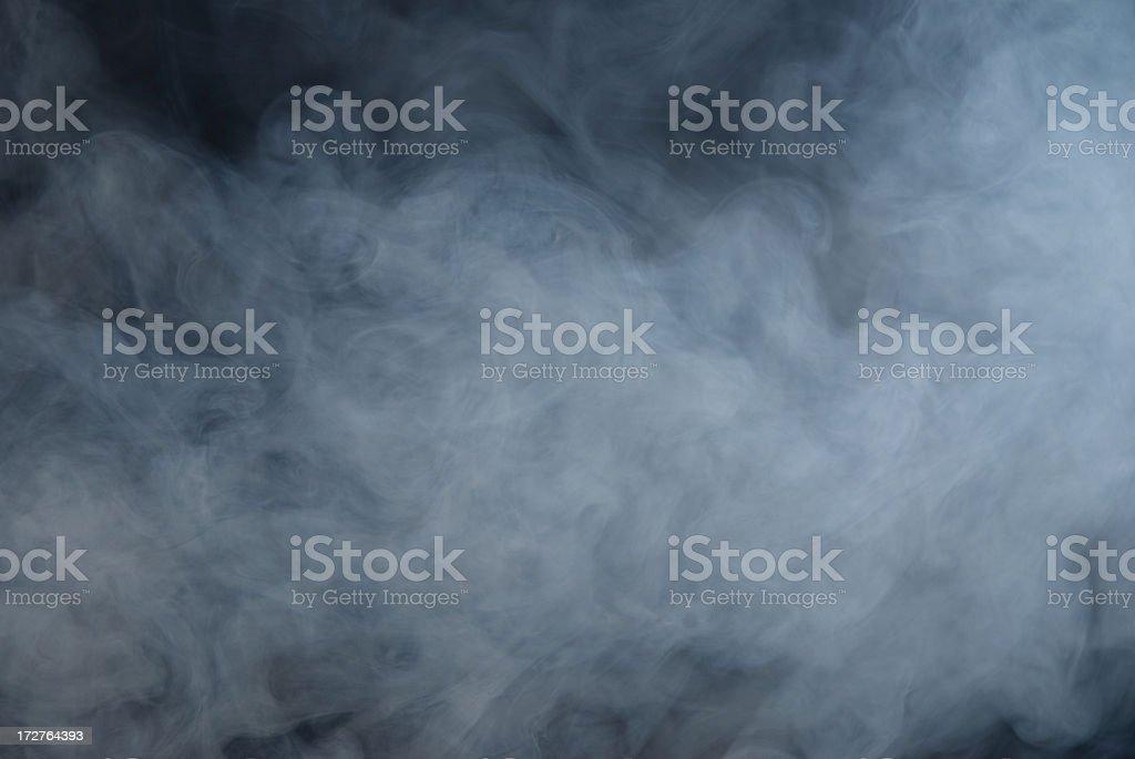 Huge white cloud of smoke in a dark room stock photo