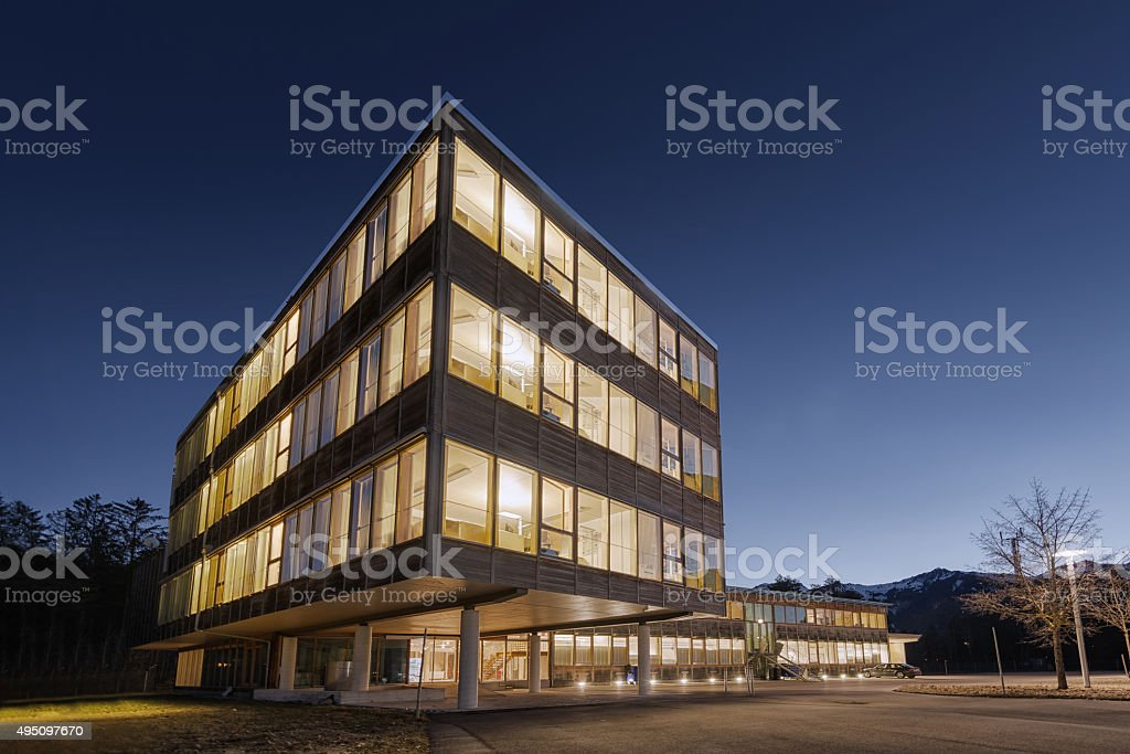 huge wooden timber sustainable office building at dawn stock photo