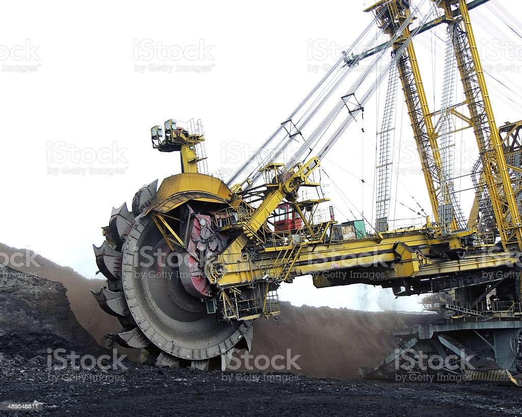 huge yellow  coal excavator in action stock photo