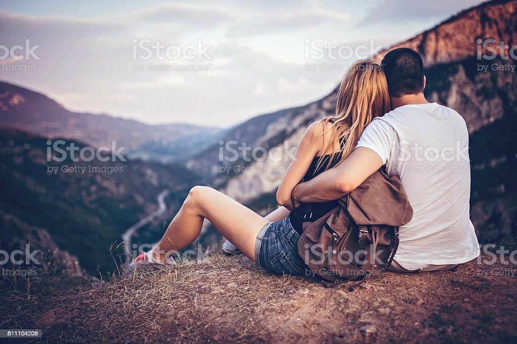 Hugged couple enjoing the sun stock photo