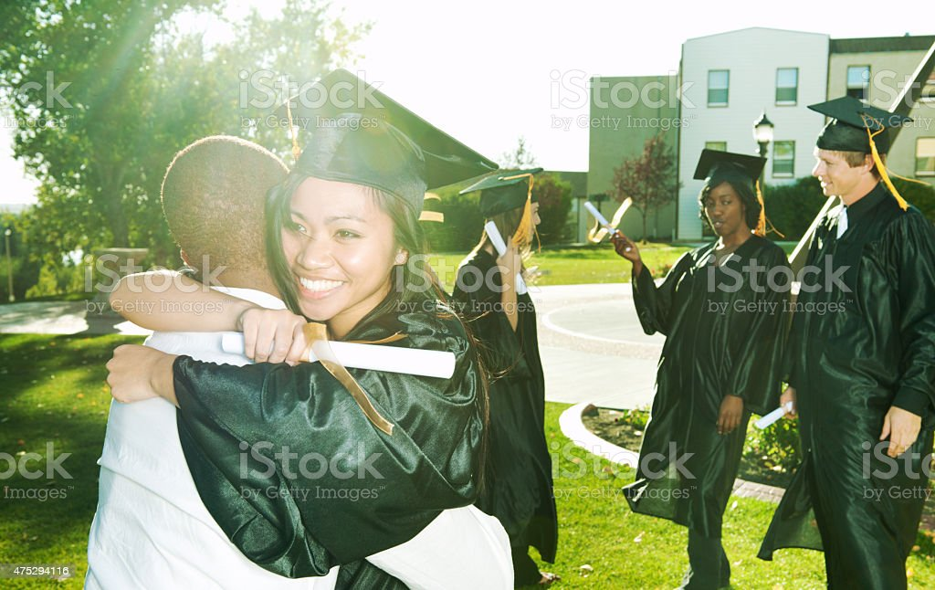 Hugging after Graduation stock photo
