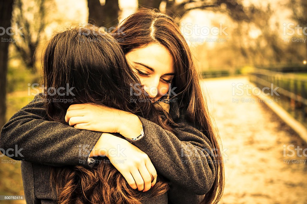 Hugging best friend stock photo