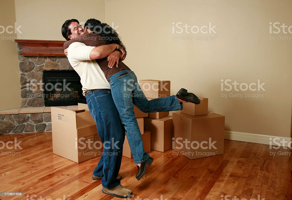 Hugging couple cheering for new home royalty-free stock photo