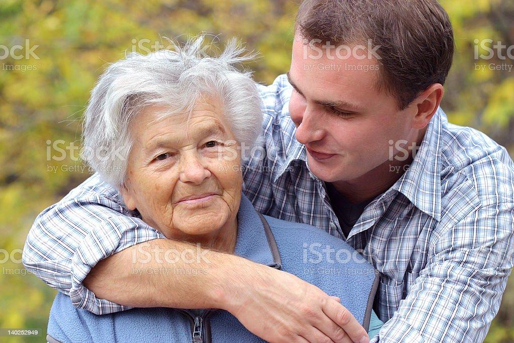 Hugging elderly person royalty-free stock photo