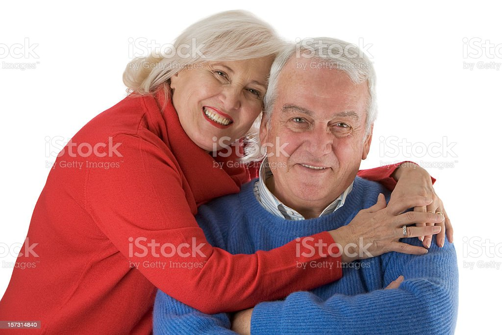 Hugging senior couple on white background royalty-free stock photo