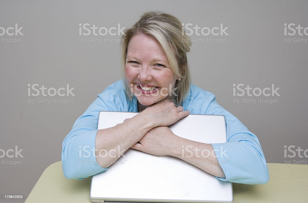 Hugging the Laptop royalty-free stock photo