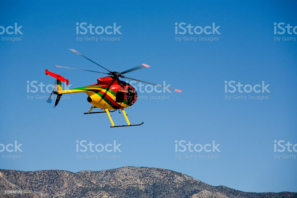 Hughes helicopter flying in the sky stock photo
