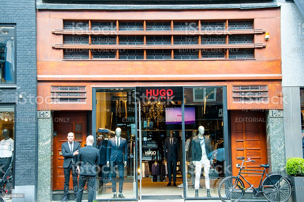 Hugo Boss store on the P.C.Hooftstraat shopping street in Amsterdam. stock photo