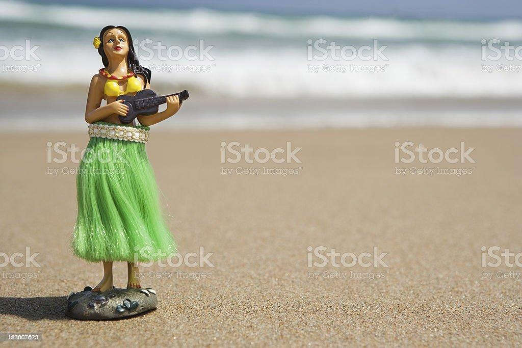 hula dancer, figurine on Beach royalty-free stock photo