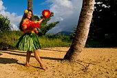 A hula dancer on a beach in Hawaii