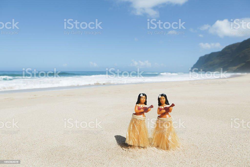 Hula Dancers Dolls on the Beach of Kauai Hawaii Hz stock photo