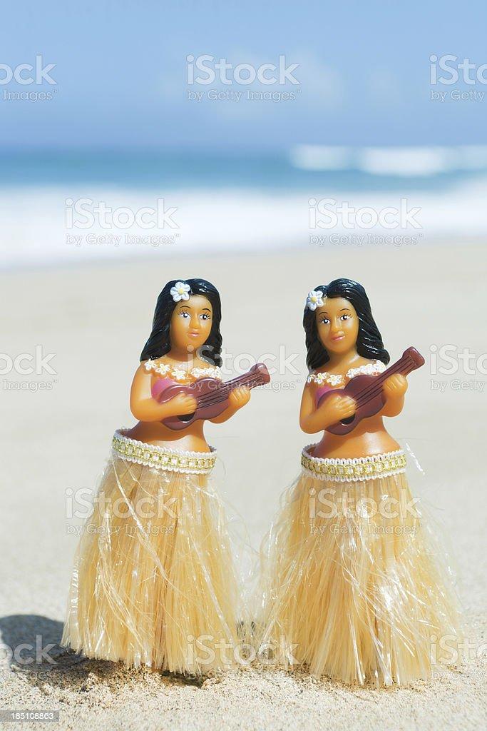 Hula Dancers Dolls on the Beach of Kauai Hawaii Vt stock photo