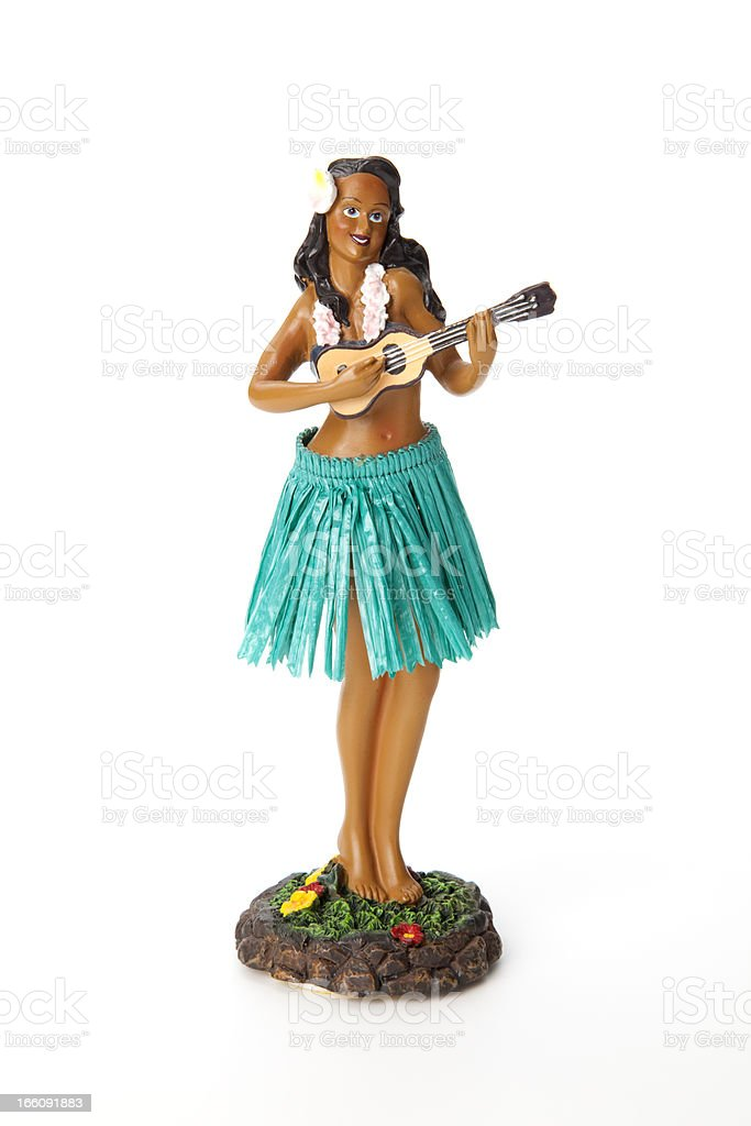 A hula doll in a grass skirt with a ukulele stock photo